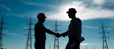 Electricity station handshake Royalty Free Stock Photography
