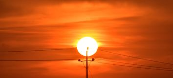 Electric supply poll with sunset photograph. The electricity supply poll pillar silhouette with sunset afternoon natural stock photograph Royalty Free Stock Photos