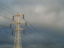 Electricity supply pylon against stormy cloudy sky Stock Photo