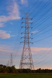 Electricity supply pylons in countryside Royalty Free Stock Photos