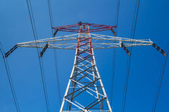 Electricity tower and a blue sky Stock Photos