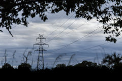 Electricity tower on a cloudscape and nature canvas Stock Photography
