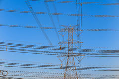 Electricity tower and electric line, power line in blue sky background Royalty Free Stock Photos