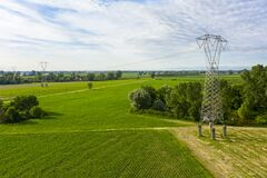 Free Electricity Tower In A Wonderful Field Stock Image - 184577761