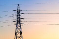 Electricity tower and lines at sunset sky, Japan Royalty Free Stock Photos