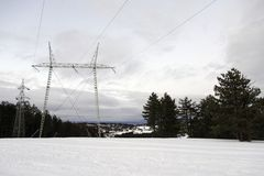 Electricity tower in the snow stock photography