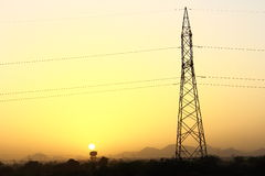 Electricity Tower during Sunset. Time Royalty Free Stock Image