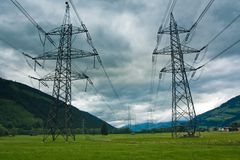 Electricity towers and cabels on cloud background royalty free stock image