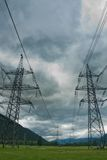 Electricity towers and cabels on cloud background Royalty Free Stock Photo