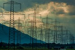 Electricity towers and cabels on cloud background Stock Photography