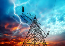 Electricity Towers. Dramatic Image of Power Distribution Station with Lightning Striking Electricity Towers stock photo