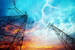 Electricity Towers. Dramatic Image of Power Distribution Station with Lightning Striking Electricity Towers Stock Image