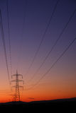 Electricity transfer lines and pylons. Electricity energy transfer lines and pylons in sunset Stock Images