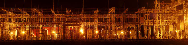 Electricity transformer distribution station panoramic at night. Power electric transformers during the night panorama view electricity distribution stock photography