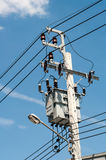 Electricity transformer mounted. On a tall pole outdoors Stock Photography