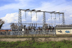 Electricity transformer station and power poles Royalty Free Stock Photography