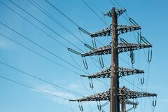 Free Electricity Transmission Line Against Clear Blue Sky. High Voltage Tower Stock Photo - 191647240
