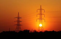 Electricity Transmission Line. Silhouette Electricity Transmission Line and sunset Royalty Free Stock Photo