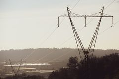 Electricity transmission power lines at sunset. High voltage tower.  royalty free stock photos