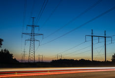 Electricity transmission power lines at sunset High voltage tower. Electricity transmission power lines at sunset High voltage tower stock photos