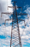 Electricity transmission power lines at sunset Royalty Free Stock Photo