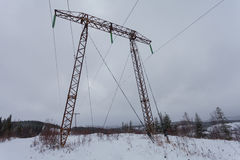 Electricity transmission power lines on winter background High voltage tower. royalty free stock photo