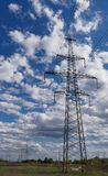 Electricity transmission pylon silhouette against blue sky at dusk royalty free stock image