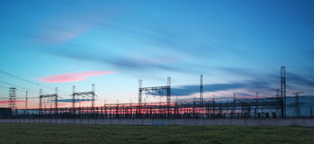 Electricity transmission pylon silhouetted against blue sky at d. Usk royalty free stock images