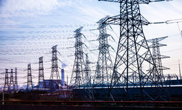 Electricity transmission pylon silhouetted royalty free stock image