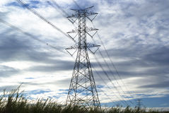 Electricity Transmission Tower. Electricity tower and power lines against the blue sky Stock Photos
