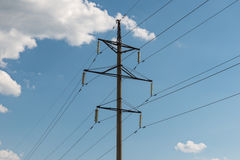 Electricity transmission tower. Against the blue sky with clouds stock photos