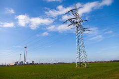 Electricity transmission tower on power house. Electricity transmission tower on a power house stock photography
