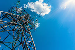 Electricity transmission tower power supply pylon. With a blue sky background stock photos