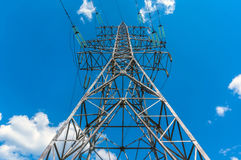 Electricity transmission tower power supply pylon. With a blue sky background stock photo