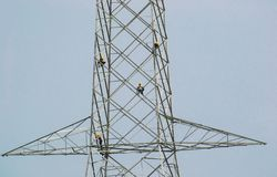 Electricity Transmission tower with workers. High Voltage Electricity or Power Transmission tower installation workers stock photos