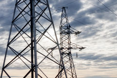 Electricity transmission towers Stock Images