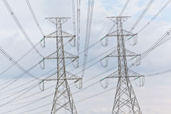 Electricity, twin High voltage power pole Royalty Free Stock Photography