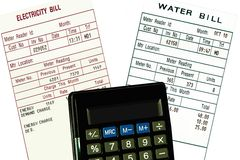 Electricity, water bills and calculator. Concept. Electricity, water bills and calculator is isolated on white. Concept Stock Image