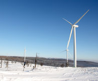 Electricity wind turbine in winter Stock Photos