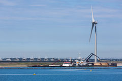 Electricity Windmill and dredging ships Royalty Free Stock Images