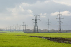 Electricity and winter-crops fields Royalty Free Stock Images