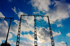 Electricity wires. Electric wires under cloudy but blue sky Stock Images