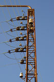 Electricity wires. Electricity wires and isolators on a metal pole Stock Photo