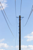 Electricity wires. And mast in summerday Royalty Free Stock Image