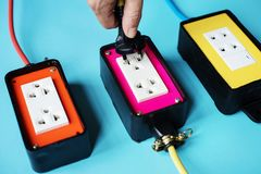 Electrics power supply plugs on blue background royalty free stock image