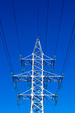 Electricty Mains Pylon. A single electric pylon mast works silently in the morning light Royalty Free Stock Photo