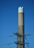 Electricty Power station chimney and pylon. An electric generating power plant chimney Royalty Free Stock Photography