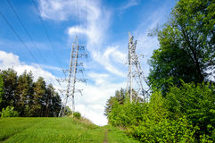 Electrification towers on the green hill horizontal Royalty Free Stock Photography