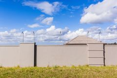 Electrified Fence House Roof  Wall Stock Images