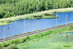 Electrified railroad in northern woods Stock Images